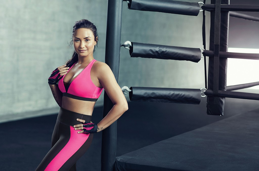 Lovato's Fabletics pieces feature bold colors and edgy cut-out designs.