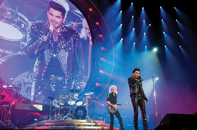 Adam Lambert performs with Brian May and Roger Taylor of Queen