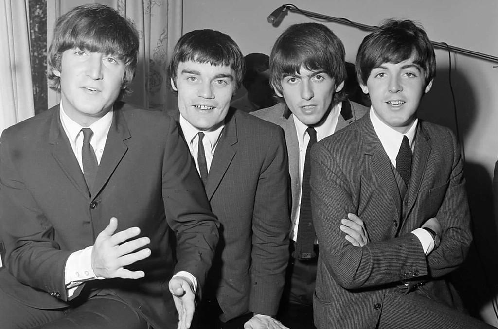 John Lennon, Jimmie Nicol, George Harrison and Paul McCartney photographed in 1964.