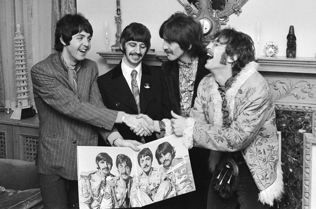 The Beatles posed with the record jacket of 'Sgt. Pepper's Lonely Hearts Club Band.'
