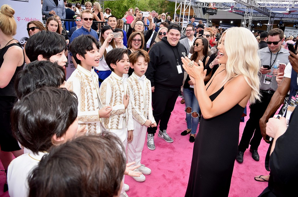 Bebe Rexha (R) with musical group YH Boys attend the 2017 Billboard Music Awards at T-Mobile Arena on May 21, 2017 in Las Vegas.