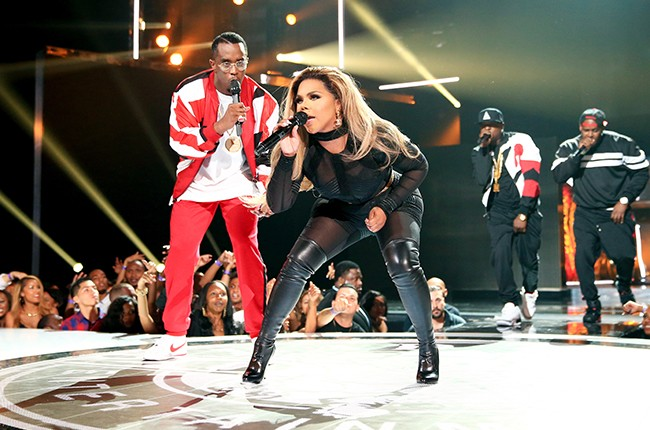 P. Diddy and Lil' Kim perform onstage during the 2015 BET Awards