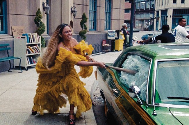 "Beyoncé wreaks havoc while wearing Cavalli in the clip for ""Hold Up"" on Lemonade."