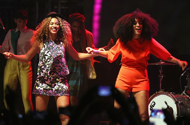 Beyonce and Solange perform onstage during day 2 of the 2014 Coachella