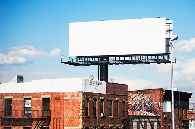 blank-billboard-over-brick-buildings-2016-billboard-650