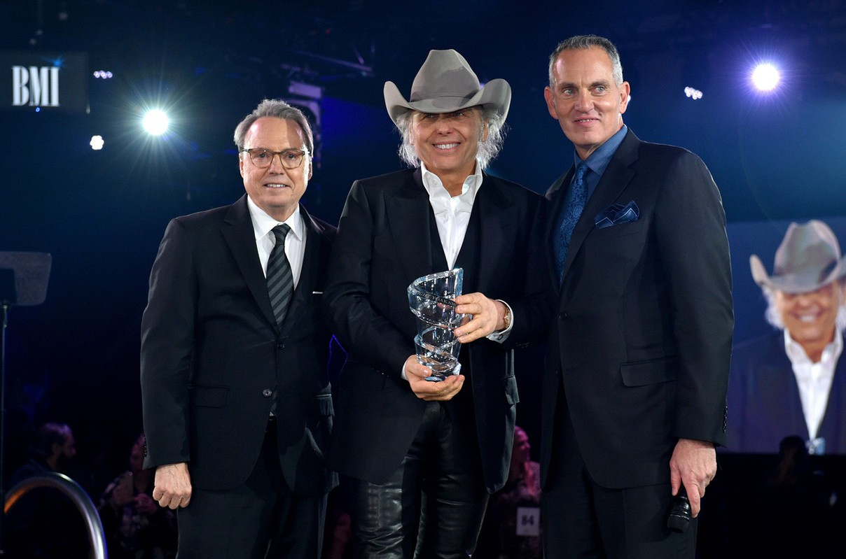 BMI Vice President Creative Jody Williams, Dwight Yoakam and BMI President & CEO Mike O'Neill onstage at the 2019 BMI Country Awards.
