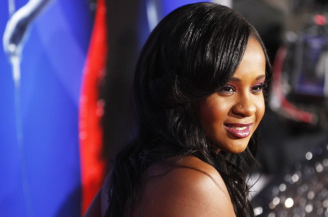 "Bobbi Kristina Brown, daughter of the late singer Whitney Houston, poses at the premiere of ""Sparkle"" in Hollywood, California on August 16, 2012."