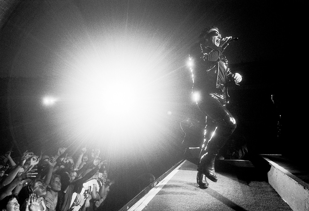 Bono performing with U2 live onstage on ZOO TV tour