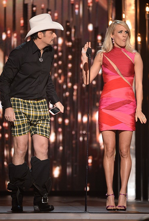 Brad Paisley and Carrie Underwood onstage at the 49th annual CMA Awards