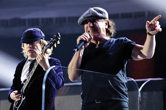 Brian Johnson and Angus Young of AC DC performs onstage during The 57th Annual GRAMMY Awards