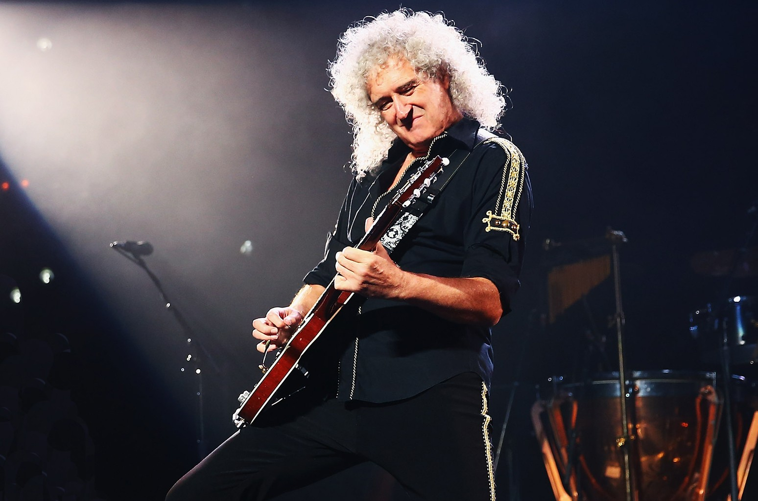 Brian May of Queen performs in 2014