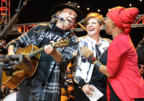Neil Young and Natalie Maines perform during the 29th Annual Bridge School Benefit
