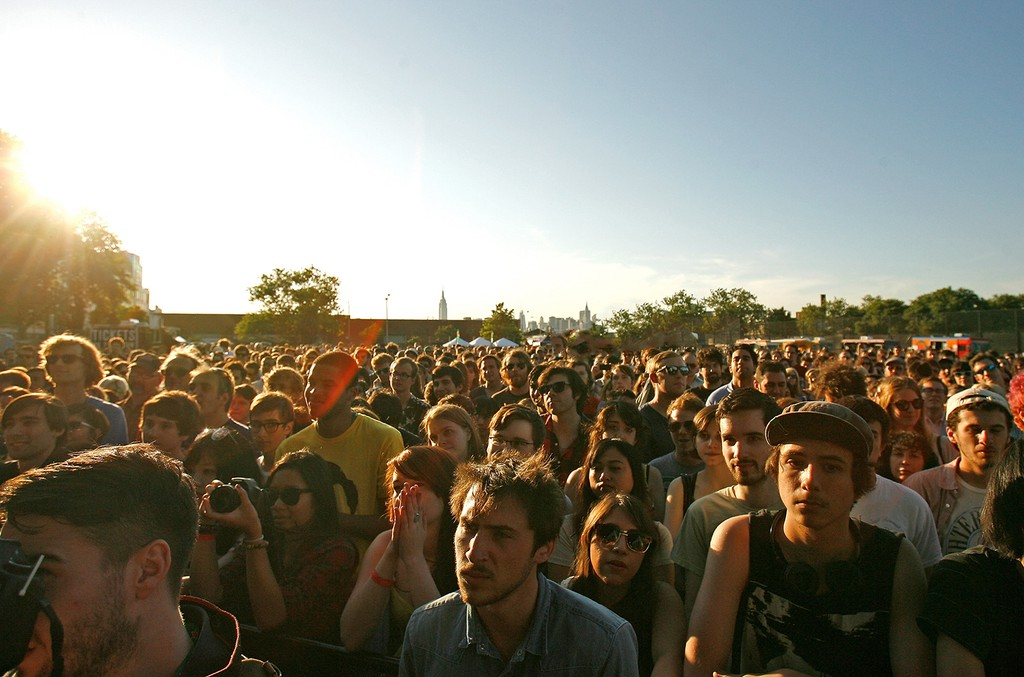 A crowd gathers for a live performance in Brooklyn