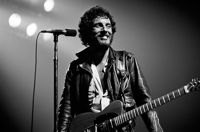 Bruce Springsteen performing on stage during his Born to Run Tour.