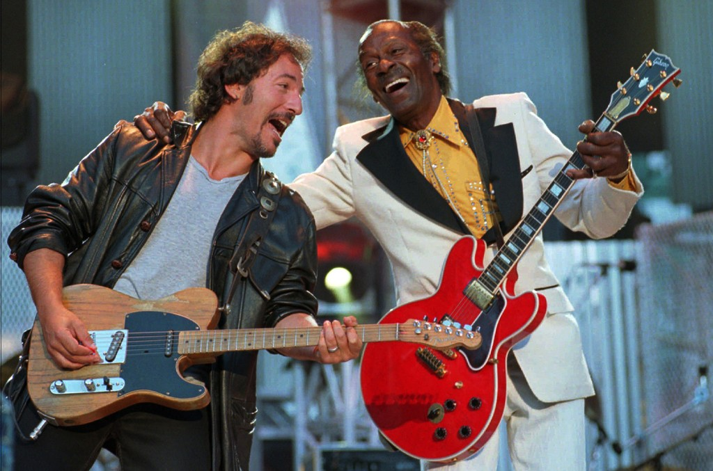 """Bruce Springsteen and Chuck Berry laugh as they perform the Berry hit """"Johnny B. Goode"""" at the Concert for the Rock and Roll Hall of Fame in Cleveland on Sept. 2, 1995."""