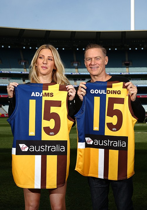 Bryan Adams and Ellie Goulding pose with Aussie Rules Football guernseys