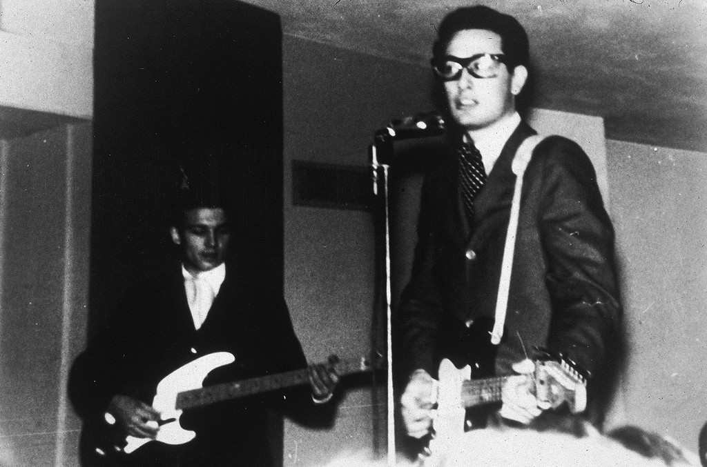 American rock musician Buddy Holly (1936 - 1959, right) performing on stage with his band The Crickets, 1950s.