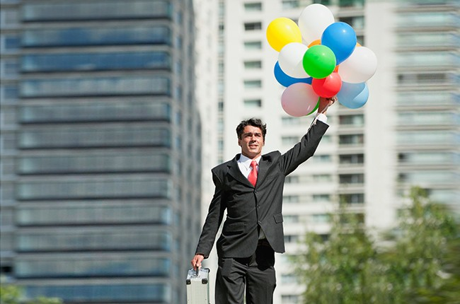 business-man-flying-with-balloons-billboard-650