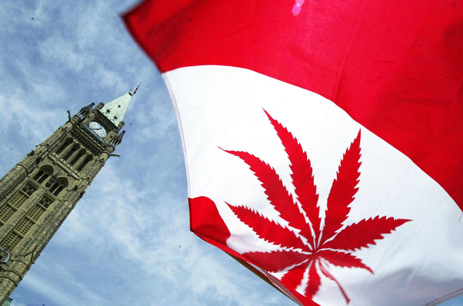 A Canadian flag with a marijuana leaf flies during a rally in support of legalizing marijuana alongside Parliament Hill in Ottawa, Canada.