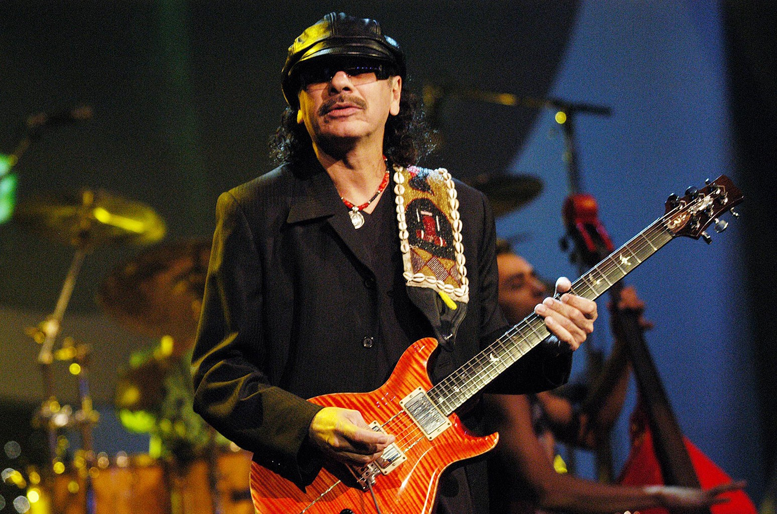 Carlos Santana performs at Jackie Gleason Theater in Miami in 2002.