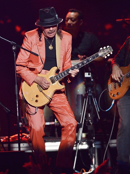 Carlos Santana performs onstage at the 2015 Billboard Latin Music Awards