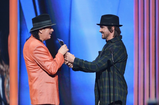 Carlos Santana receives award by Juanes at the 2015 Billboard Latin Music Awards