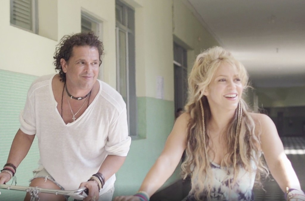 "Carlos Vives and Shakira in the video for ""La Bicicleta."""