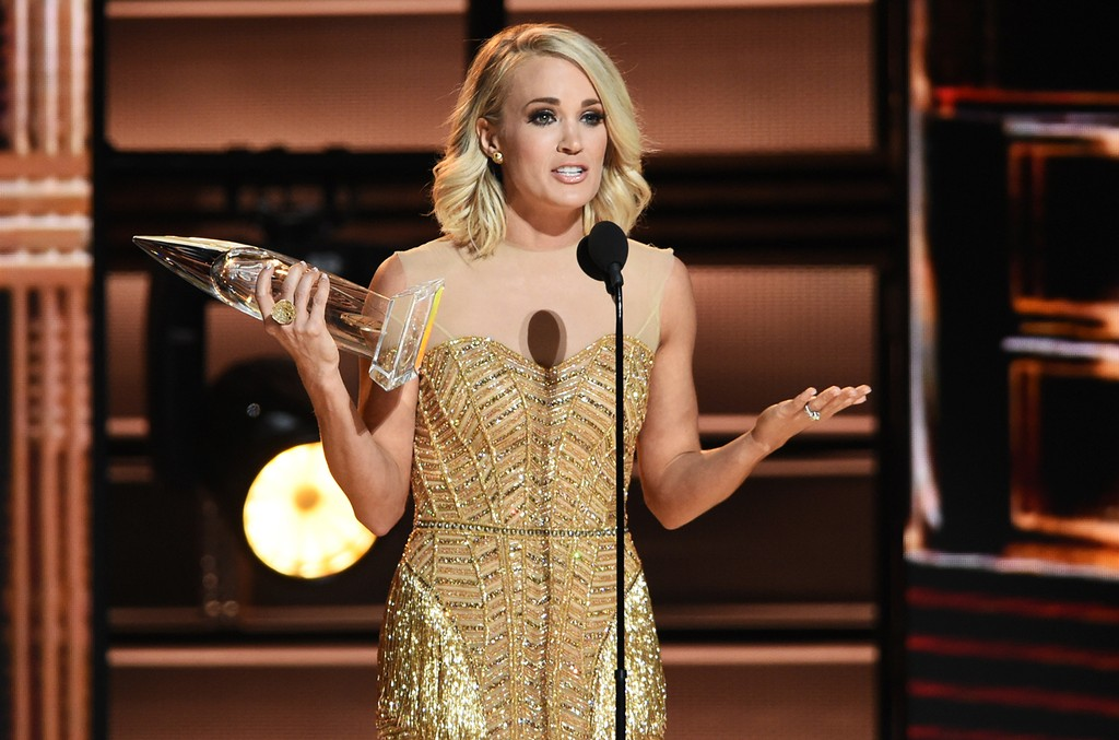 Carrie Underwood accepts and award onstage at the 50th annual CMA Awards