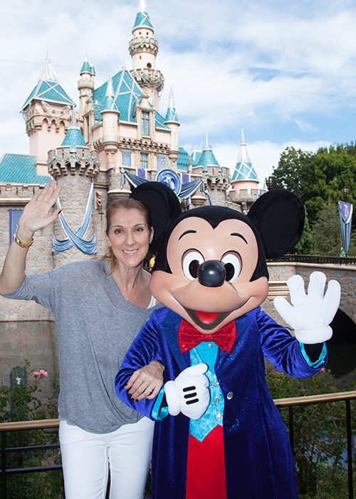Celine Dion poses with Mickey Mouse at Disneyland