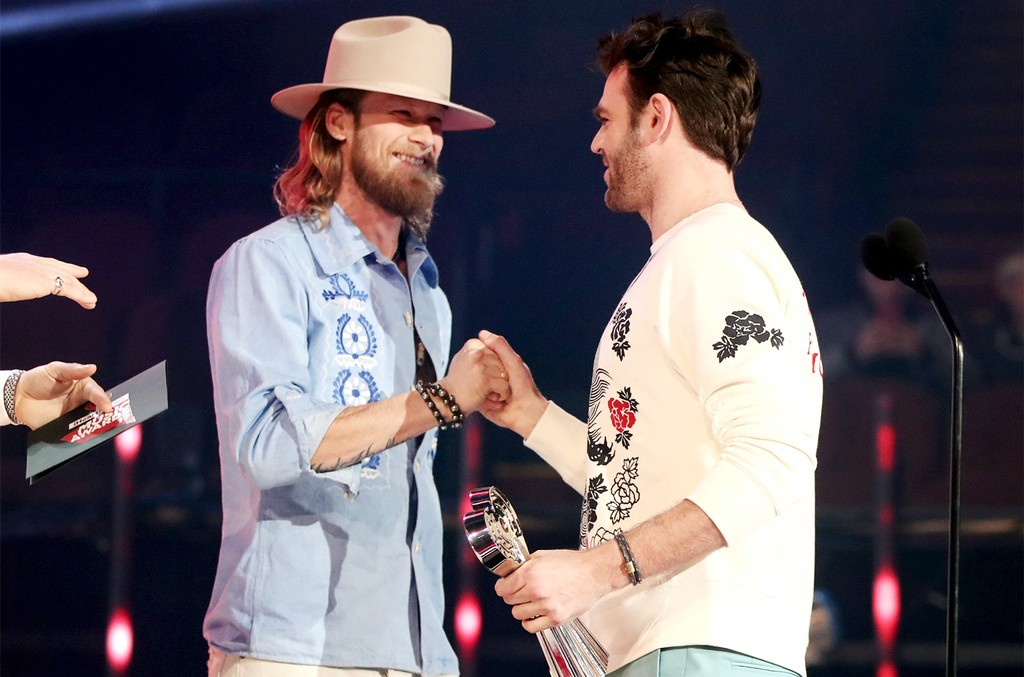 Brian Kelley of Florida Georgia Line presents the Brand New Artist award to recording artist Alex Pall of music group The Chainsmokers onstage at the 2017 iHeartRadio Music Awards at The Forum on March 5, 2017 in Inglewood, Calif.