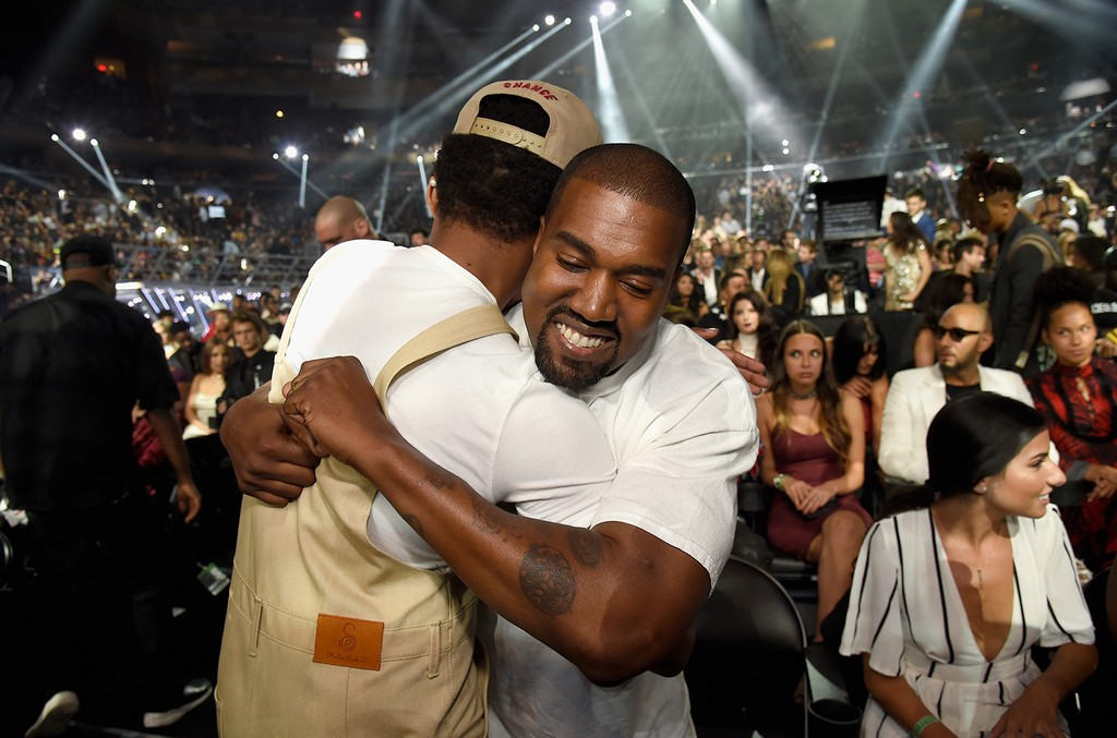 Chance the Rapper hugs Kanye West
