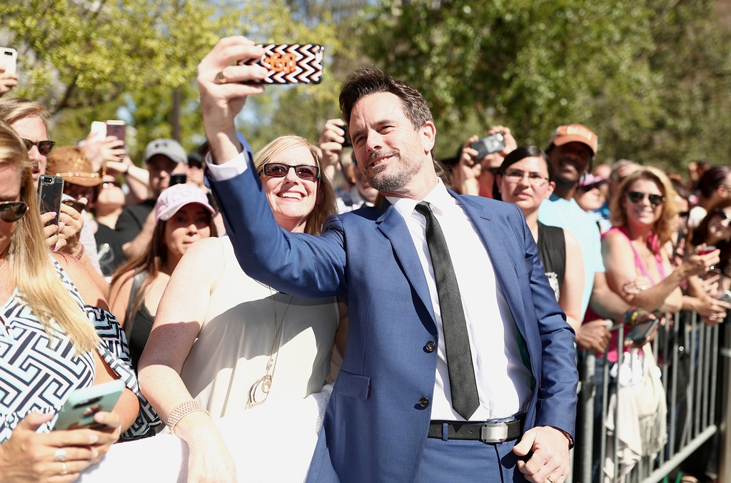 Charles Esten poses for a selfie with a fan before the 52nd Academy Of Country Music Awards at Toshiba Plaza on April 2, 2017 in Las Vegas.