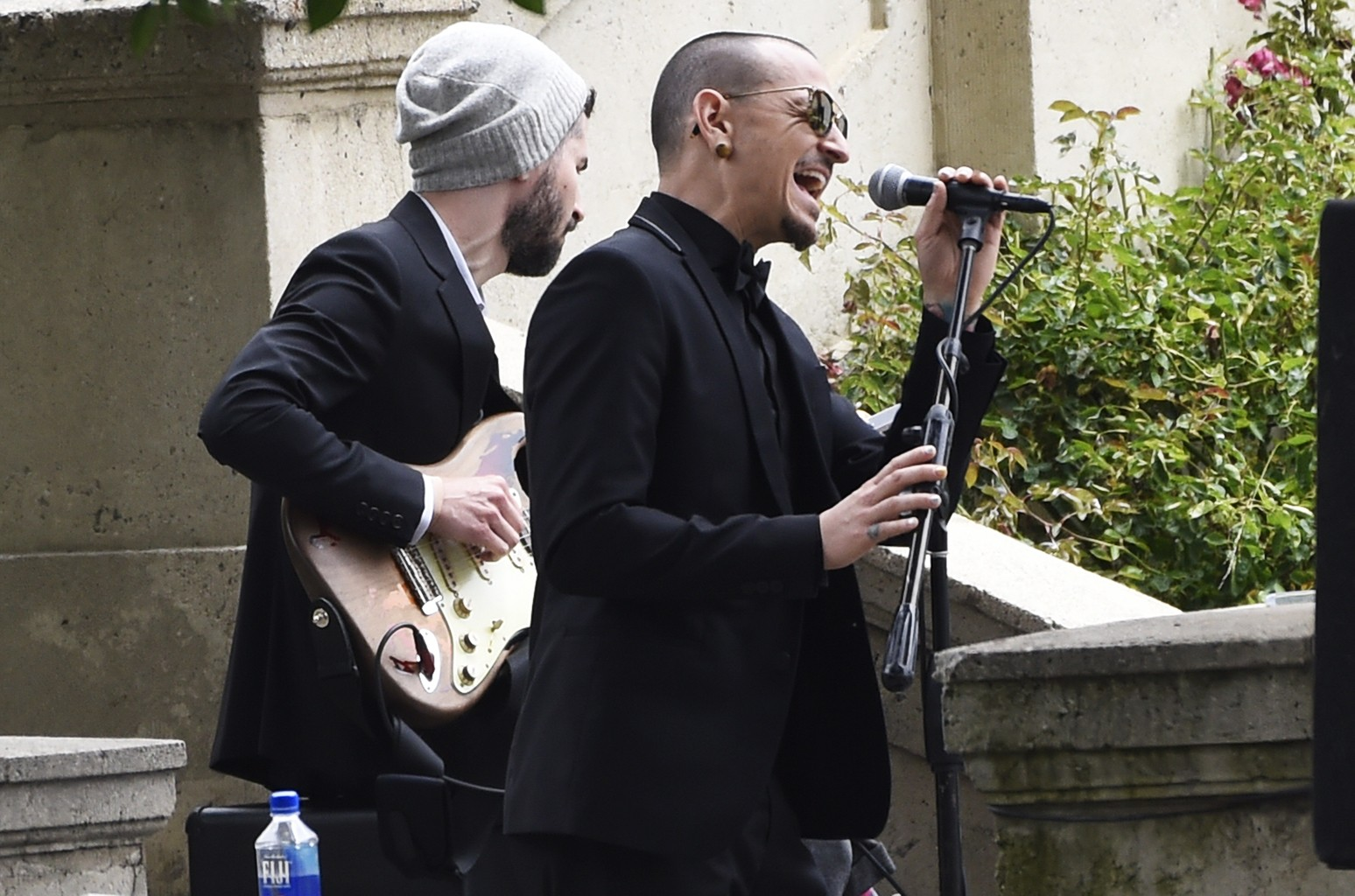 """Chester Bennington and Brad Delson of Linkin Park perform """"Hallelujah"""" at Chris Cornell's funeral at the Hollywood Forever Cemetery on May 26, 2017 in Los Angeles."""