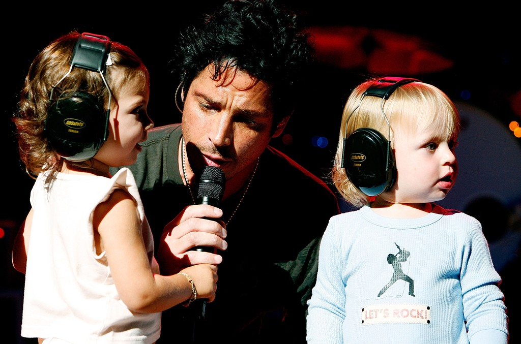 Chris Cornell and his children Toni and Christopher on stage during a concert at the Beacon Theatre on July 31, 2007 in New York City.