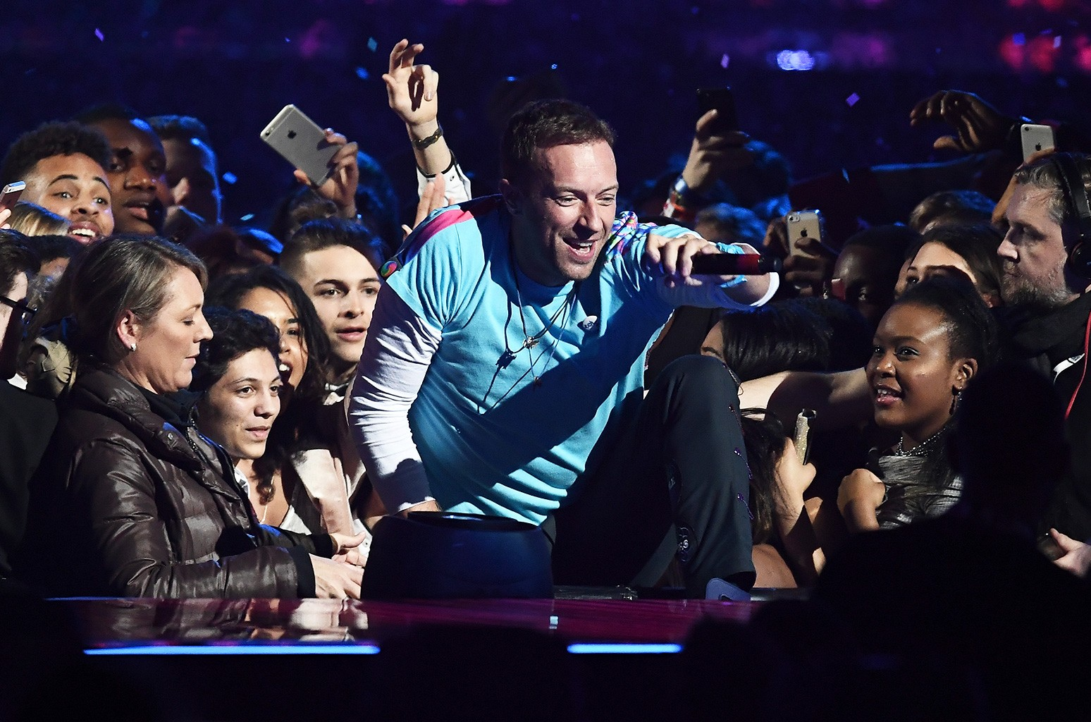 Chris Martin of Coldplay performs with The Chainsmokers on stage at The Brit Awards 2017 at The O2 Arena on Feb. 22, 2017 in London, England.