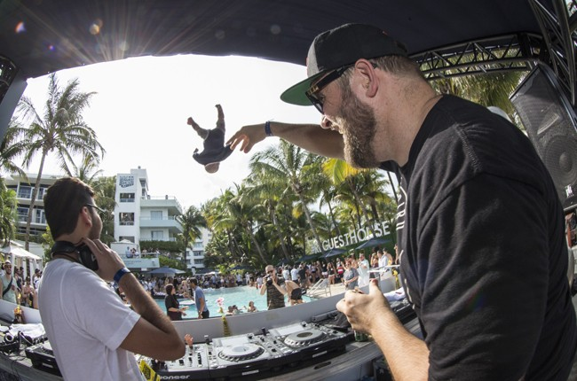 Claude Von Stroke throws a doll to the audience at Red Bull Guest House in Miami