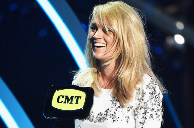 Carrie Underwood accepts an award onstage during the 2015 CMT Music Awards