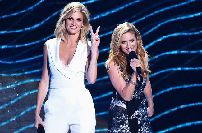 Erin Andrews and Brittany Snow speak onstage during the 2015 CMT Music Awards