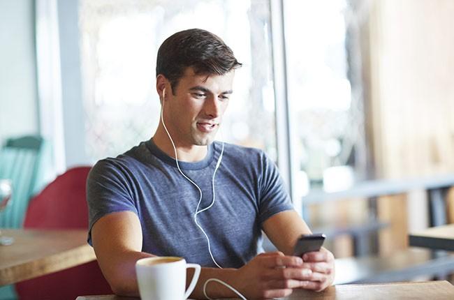 coffee-shop-guy-headphones-music-2014-billboard-650