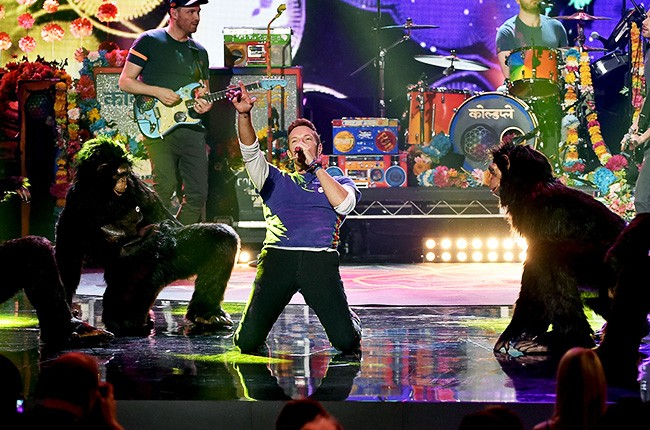 Coldplay perform onstage during the 2015 American Music Awards