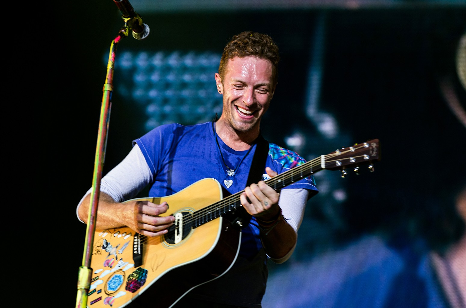 Chris Martin of Coldplay performs in England