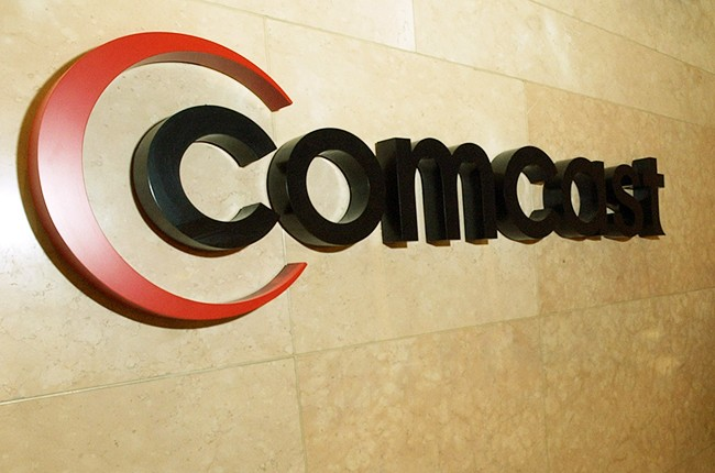 A Comcast logo hangs in the lobby of their corporate headquarters in Philadelphia, Pennsylvania.