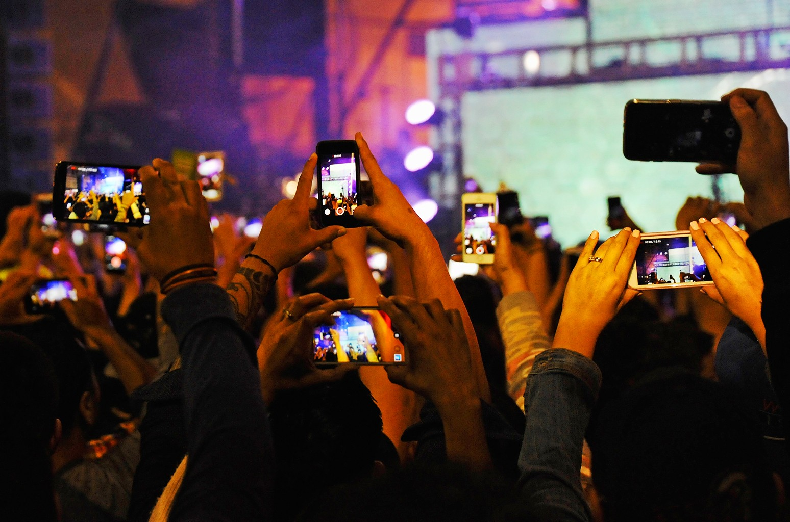 Atmosphere shot of a cluster of cell phones at the 'LAoki' concert in Downtown Los Angeles on May 16, 2015 in Los Angeles.