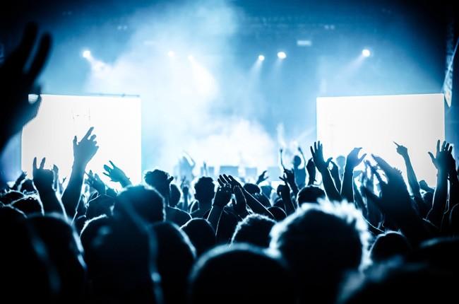 Trance music fans enjoy a concert.