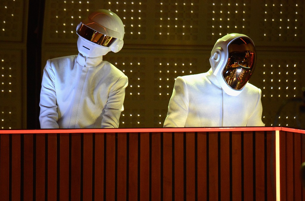 Daft Punk perform onstage during the 56th Grammy Awards