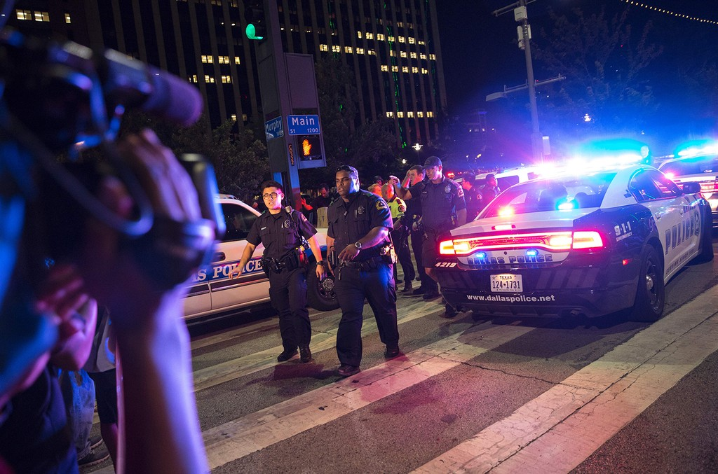 Bystanders stand near police barricade in Dallas