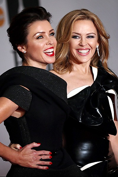 dani-minogue-kylie-minogue-brit-awards-red-carpet-2014-600
