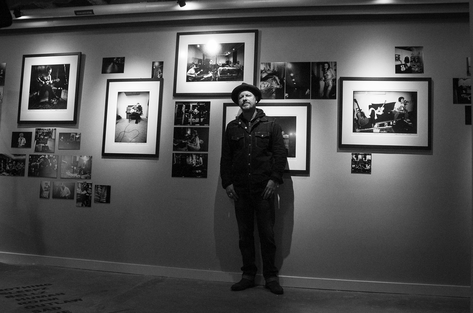 Danny Clinch with photos at his exhibit 'Transparent' at The Asbury Hotel.