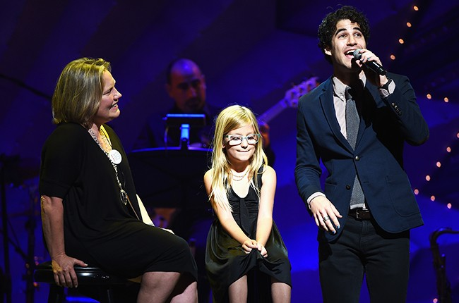 Darren Criss performs on stage with honorees during Voices For The Voiceless