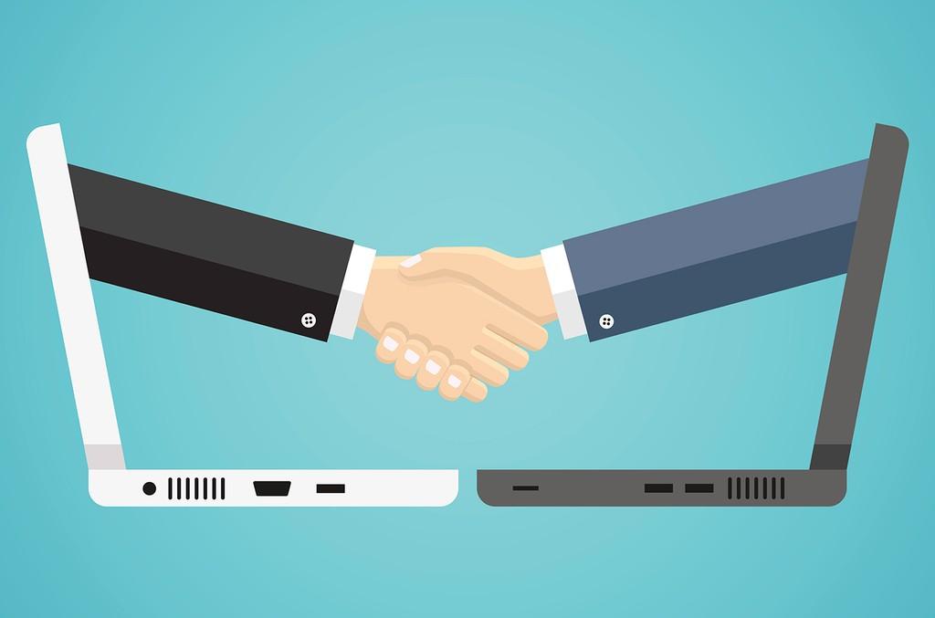 deal-handshake-computer-2018-billboard-1548